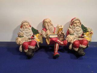 three Christmas stocking holders