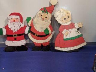 three Christmas cutouts