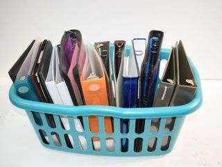 laundry Basket of Binders and Clipboards