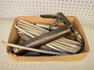 Box of Grease Guns and Springs