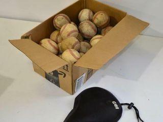Box of Baseballs and Bike Seat Cover