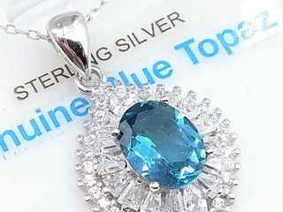 Sterling Silver 9x7mm genuine Blue Topaz  1 5cts