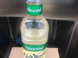 Four bottles of almond beverage flavoring great for coffee and hot beverages