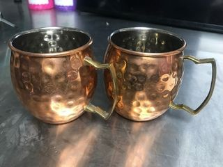 Two copper Moscow mule mugs