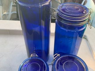 Set of blue glass food storage canisters