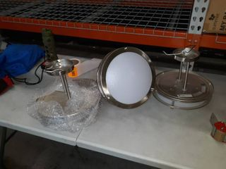 3 circular chrome lights