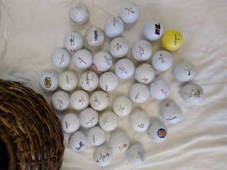 lot of golf balls in basket