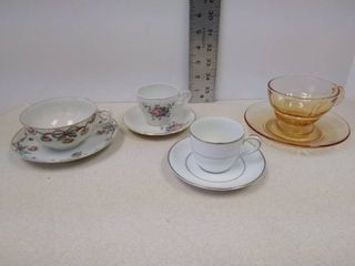 4 teacups and saucers