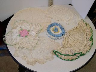 set of crocheted and lace doilies