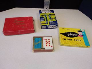 Canasta cards  card tray  score pad and Yahtzee score pads and Waterworks game