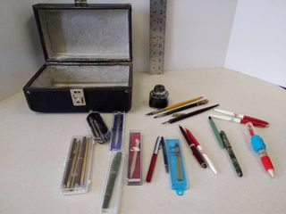 lot of pens  pencils and ink