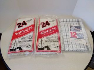two packages of utility towels and one package of kitchen tiles