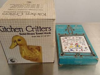 Kitchen Critters brass towel hook and decorated tile trivets