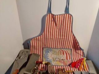 lot of various and vintage kitchen and grilling utensils and apron