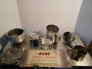 lot of  sifters and serving bowls and grater