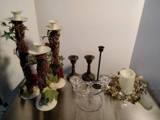 lot of candle holders and battery powered candle