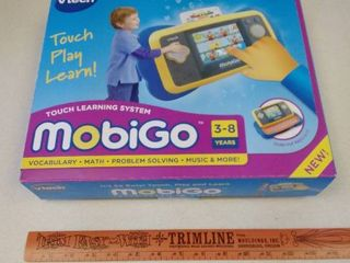 Vtech Mobigo touch learning system in box  used  untested  Toy Story 3 learning game unopened