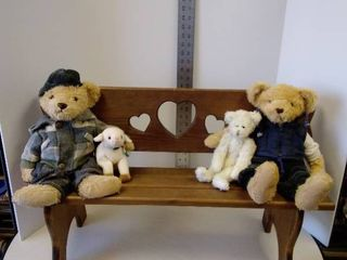 Wood bench with stuffed bears and lamb