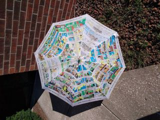 KC Star umbre umbrella  and small yellow umbrella