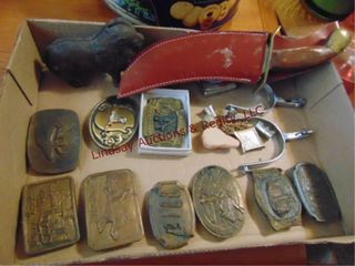 Flat of belt buckles  zippo  spurs  knife