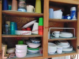 2 cabinets of misc dishes  plates  bowls  cups