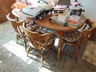 Oval wood dining table w  leaf   5 chairs