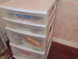 Plastic organizer with office supplies  has wheel