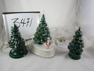 Trio of pottery Christmas trees that illuminate