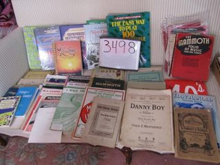 Sheet music and song books spannin several decades