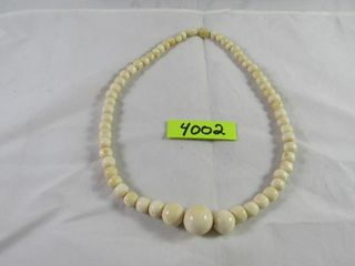 Ivory necklace bought in the Ivory coast 1980