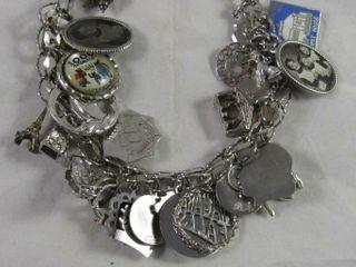 Sterling charm bracelet 75 79 grams w  assorted