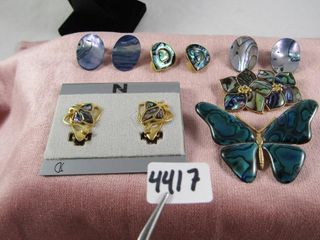 Albone Brooches and clip earrings