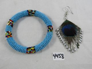 Indigenous beaded bangle and one feather earring