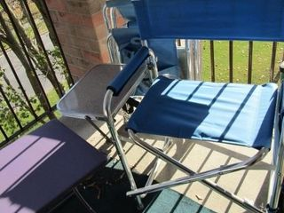 Pair of folding lawn chairs with side table