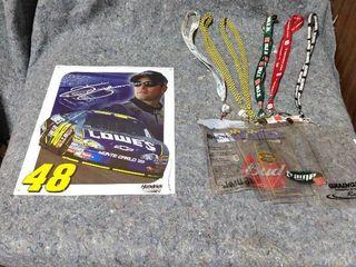 metal NASCAR sign and lanyards
