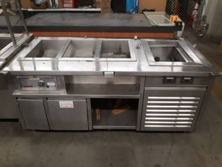 Stainless steel counter with steam compartment