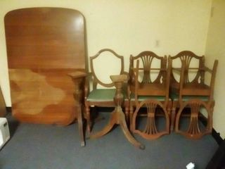 Vintage Walnut Dining Table legs are 30 in Tall Table Top is 60 x 40 in with 5 Chairs Needs Repairs