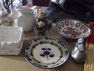 serving plates   tea pot   pitcher   duck