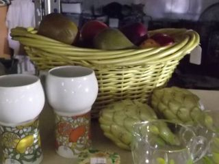 wicker fake fruit basket and fake veggies