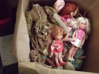 box of baby dolls and doll clothing