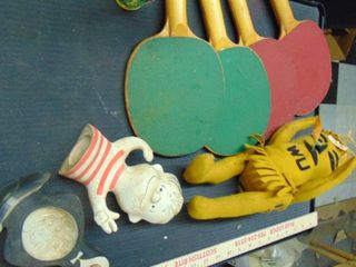 Old Wu shock doll   ping pong paddles   linus and penguin