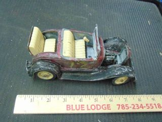 old metal toy car with rumble seat