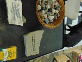 Bowl of various rocks   Stone plaques   Crayons