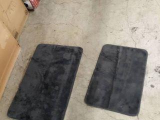 2 gray bath mats