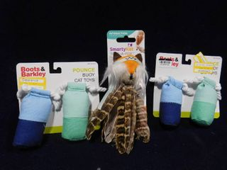 Boots Barkley 2 sets of 2 pounce buoy cat toys and Smarty Kat Toss A Fox feathery toy