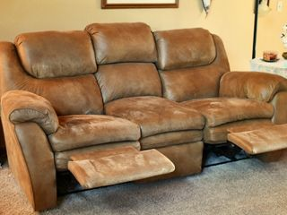 reclining sofa has a drawer in the center