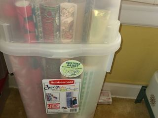 RUBBERMAID Jumbo Wrap n Craft  Has a holder for ribbon and bows  And has several various rolls of wrapping Paper