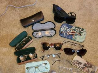 GlASSES  lot of sunglasses  readers and a few script