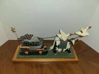 WIllIRAE STUDIO Santa Pulling Sled led by Cow and Geese