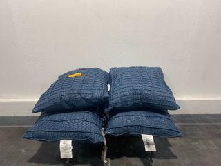four outdoor blue pillows